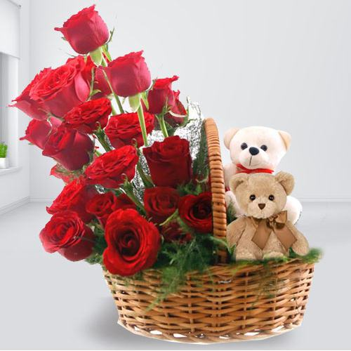 Beautiful Arrangement of Red Roses with Twin Teddy to Faridabad