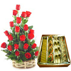 1/2 Kg. Assorted Sweets with 18 Red Roses Basket   to Calicut