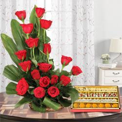 Bright charming 18 Red Roses and delicious mixed Sweets to Baroda