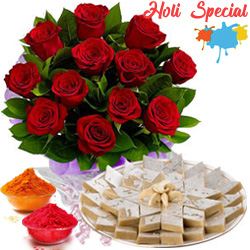 Charming 1 dozen Red Roses along with appetizing Kaju Katli to Ahmedabad