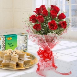 Charming 1 dozen Red Roses along with appetizing Kaju Katli to Bolpur