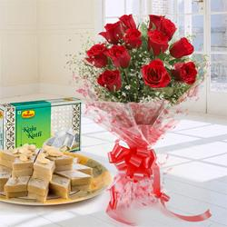 Charming 1 dozen Red Roses along with appetizing Kaju Katli to Barauipur