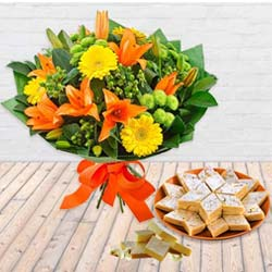 Pretty Seasonal Flower bouquet with yummy Kaju Barfi to Ludhiana