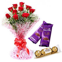 Lovely Surprise Red Rose Bouquet with Dairy Milk Silk and Ferrero Roacher Chocolates to Kolar
