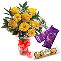 Thoughtful Arrangement of Yellow Roses with Ferrero and Dairy Milk Silk Chocolate to Thane