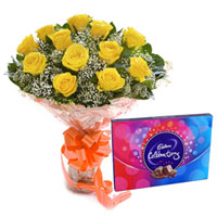 Delectable Combo of Cadbury Celebration and Bouquet of Red Roses to Pune
