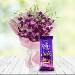 Splendid Purple Orchids Bouquet with Delicious Cadbury Silk to Mohali
