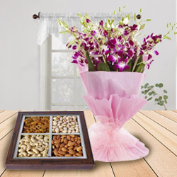 Birthday Overflowing Combo of Dry Fruits and Orchids Bouquet to Allahabad
