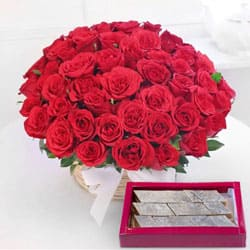 Astonishing 50 Red Roses along with delicious Kaju Barfi to Baraut