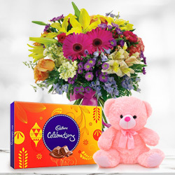 B Day Expressive Mixed Flower in a Vase with Small Teddy and Tasty Cadbury Celebration Chocolates to Trichur