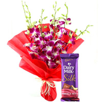 Splendid Purple Orchids Bouquet with Delicious Cadbury Silk to Amlapuram