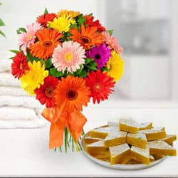 Yummy Kaju Katli and Arrangement of Mixed Gerberas to Ahmedabad