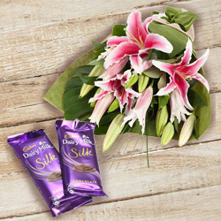 Magnificent Bouquet of Pink Lilies and Dairy Milk Silk to Trichur