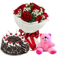 Sweet Surprise Anniversary Black Forest Cake, Red Rose Bouquet and Small Teddy to Chirala