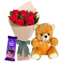 Delectable Dairy Milk Silk with Teddy N Red Roses Bouquet to Berhampur