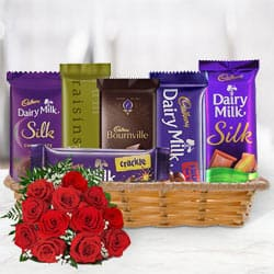 Attractive Gift Basket of Cadbury Chocolates with Red Roses to Barauipur