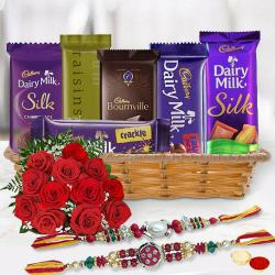 Gift Hamper of Cadbury Chocolates with Red Roses with 2 Rakhi, Roli, Tilak and Chawal to Bhiwadi
