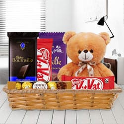 Attractive Gift Basket of Delightful Chocolates with Teddy to Trichy