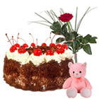 Delicious 1/2 Kg. Cake with charming Red Roses and cute Teddy Bear to Gadag