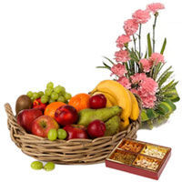 Pleasant Selection of Fresh Fruits Basket with Mixed Dry Fruits and Pink Carnations Basket to Hubli