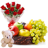 Deluxe Combo of Cute Teddy with Mixed Fruits Basket and Red Roses Arrangement to Tirunelveli