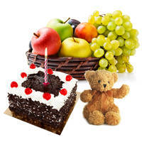 Online Gift of Delicious Black Forest Cake and Small Teddy with Candles and Fruits Basket to Chennai