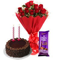 Online Midnight Combo of Dairy Milk Silk, Chocolate Cake n Candles with Red Roses Bouquet to Cuddapah