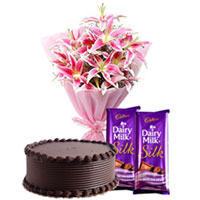 Charming Present of Sweet Dairy Milk Silk with Lilies Bouquet and Chocolate Cake for Midnight Delivery to Calicut