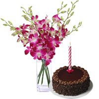 Delightful Midnight Gift of Delectable Chocolate Cake with Candles and Beautiful Orchids in vase to Hyderabad