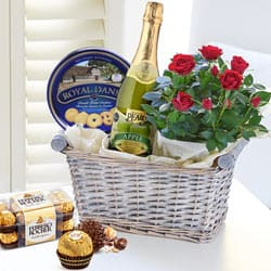 Mesmerizing Tear N Share Gift Basket with Rose Bouquet to Bhavnagar