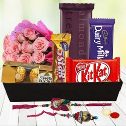Sweet N Savory Chocolate Hamper with Pink Roses with Bhaiya Bhabhi Rakhi, Roli, Tilak and Chawal to Chandrapur