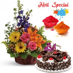 Vibrant Floral arrangement added with an appetizing Black Forest Cake and to Solapur