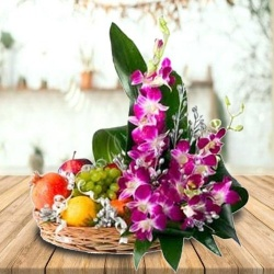 Mouth-watering assorted Fruit basket with charming Flowers to Bolpur