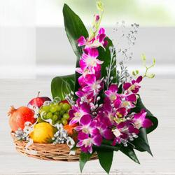 Mouth-watering assorted Fruit basket with charming Flowers  to Bhopal