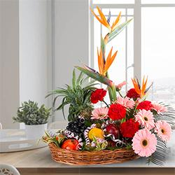 Tasty Fresh Fruits Basket with Mixed Flowers to India