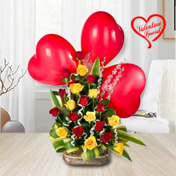 Colorful Roses along with adorable heart Shaped Red Balloons to Cochin