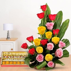 Resplendent 20 Roses and tasty assorted Sweets to Hyderabad