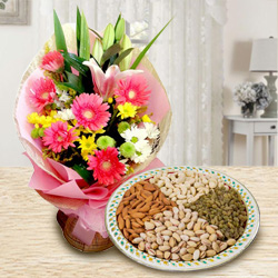 Charming Seasonal Flowers with healthy Dry Fruits to Cochin