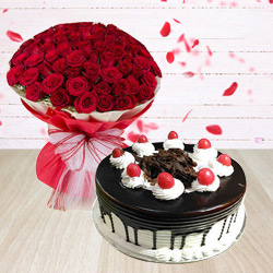 Extravagant Red Roses Arrangement with Black Forest Cake to Ahmedabad
