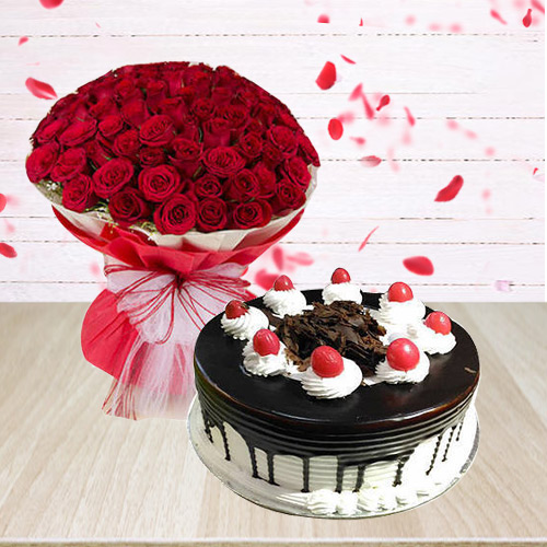 Extravagant Red Roses Arrangement with Black Fores... to Anand