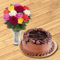 Gorgeous colorful Roses along with a Vase with delectable Chocolate Cake to Surat