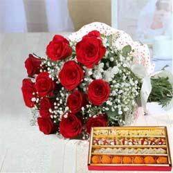 Stunning Red Roses along with yummy assorted Sweets to Vellore