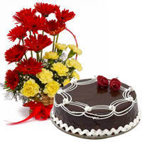 Mesmerizing Carnations and Gerberas Arrangement with 1/2 Kg Dark Chocolate Cake to Bellary