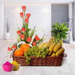 Bright charming Pink Roses combined with fresh Fruits Basket to Adilabad