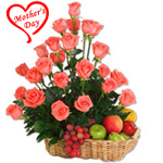 Bright charming Pink Roses combined with fresh Fruits Basket to Hyderabad