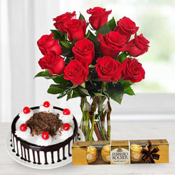 Gorgeous Bouquet of bright Red Roses, tasty Ferroro Rocher and delicious Black Forest Cake to Tirunelveli