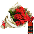 Stylish Arrangement of Red Roses and Fruit Juice to Solapur