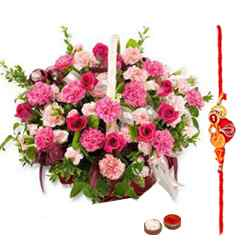 A floral basket containing roses and Seasonal Flowers with free Rakhi, Roli Tika and Chawal to Bhilai