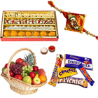 Assorted Cadburys Chocolates with Kaju Katli, Fresh Fruit Basket, Free Rakhi, Roli Tilak and Chawal to Bangalore