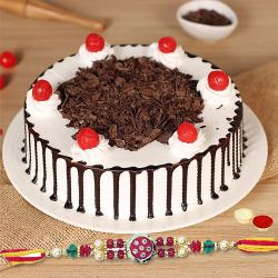 A charming Black Forest cake,Rakhi, with free Roli Tika and Chawal to Gurgaon